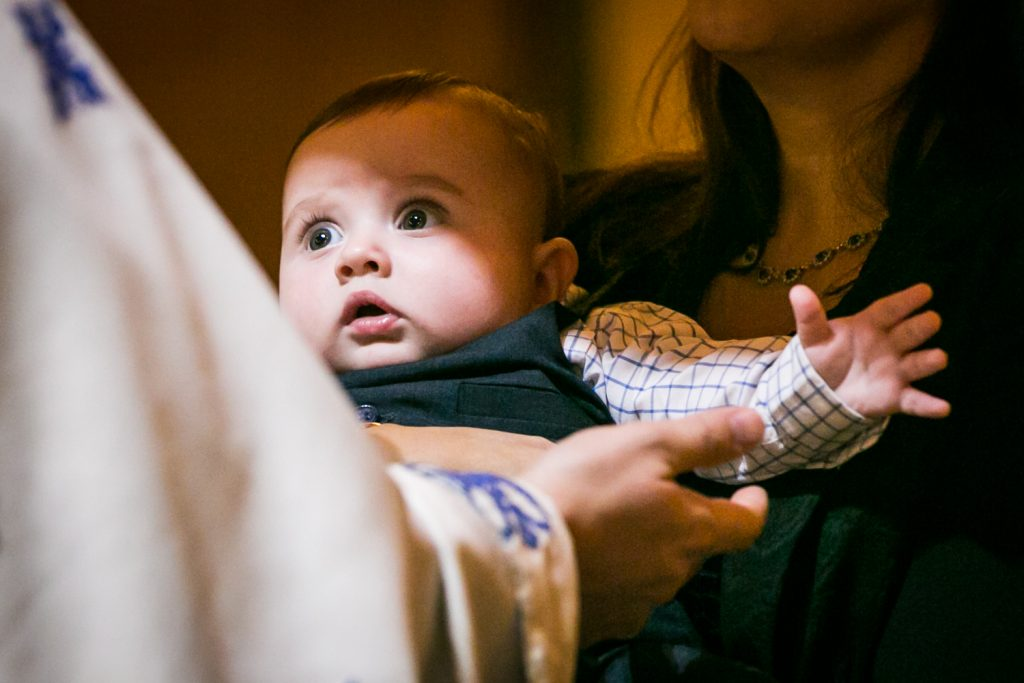 Light shining on baby by NYC Greek orthodox baptism photographer, Kelly Williams
