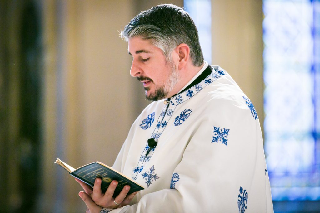 Priest during ceremony by NYC Greek orthodox baptism photographer, Kelly Williams
