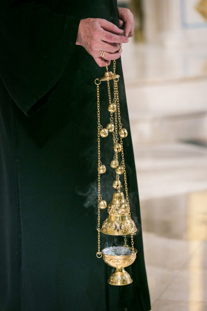 Close up on burning incense lantern by NYC Greek orthodox baptism photographer, Kelly Williams