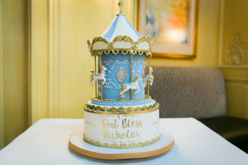 Carousel-themed cake for baptism reception at Arabelle Restaurant