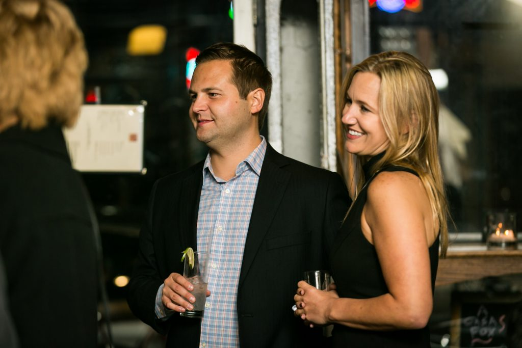 Two guests smiling for an article on rehearsal dinner tips