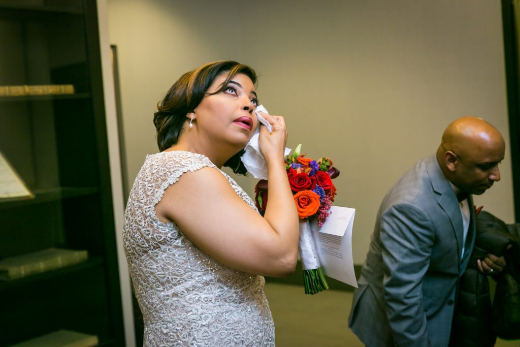 Bride wiping away a tear after City Hall wedding