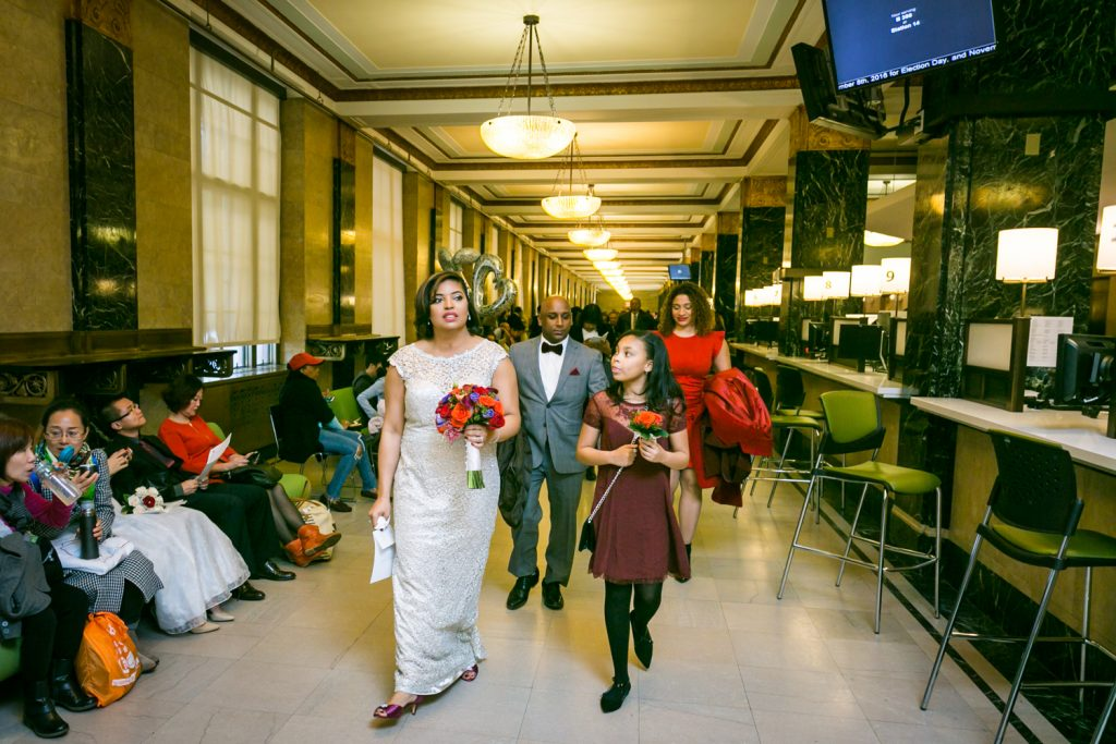 Bride and guests walking out of City Clerk's Office after City Hall wedding