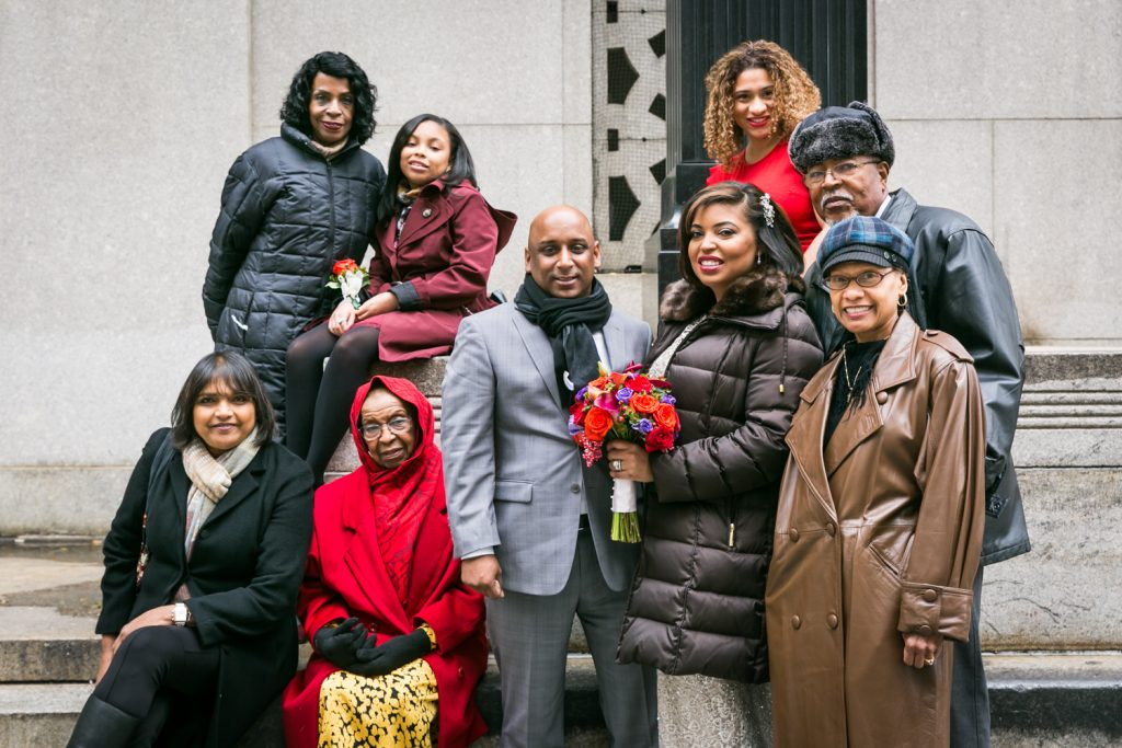 Portrait of bridal party wearing puffy coats after NYC City Hall wedding