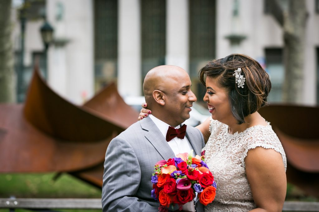 Bride and groom looking at each other after City Hall wedding for an article on wedding website tips
