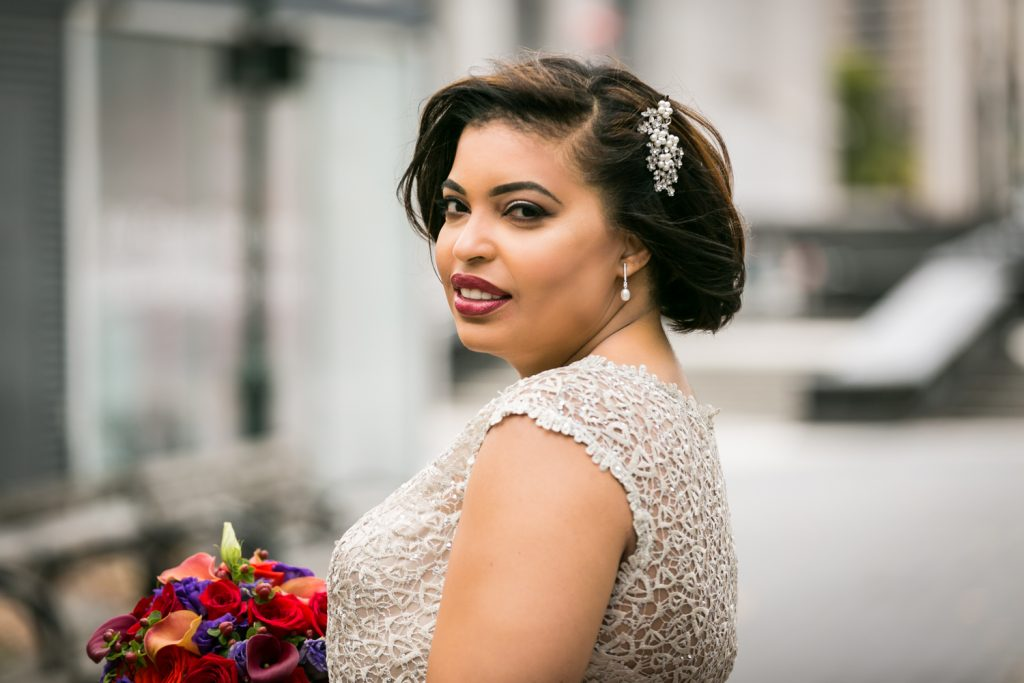 Portrait of bride looking over her shoulder for an article on wedding website tips
