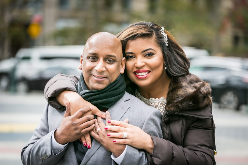 Portrait of bride with arm around groom for an article on wedding website tips