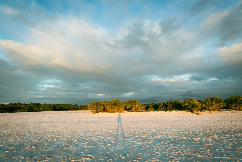 Shadow of photographer on sand of Honeymoon Island beach