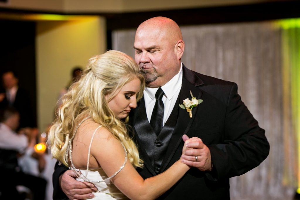 Bride and father dancing for an article on how DJ lighting affects your wedding photos