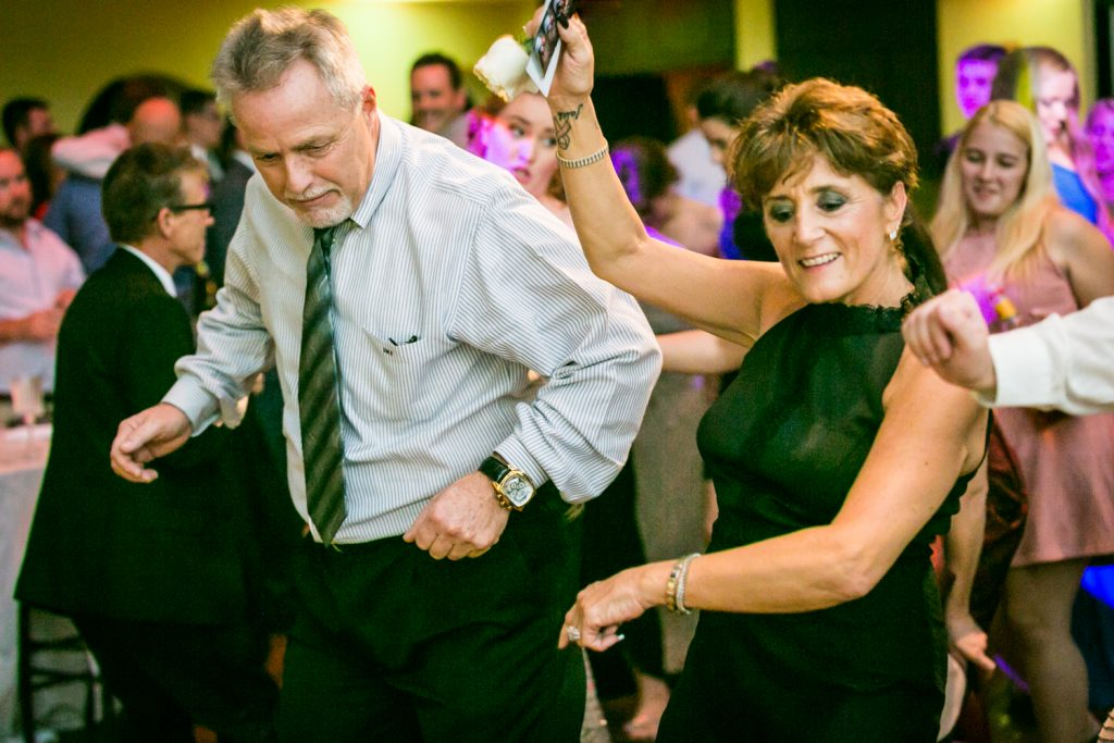 Guests dancing at a West Palm Beach wedding reception for an article on how DJ lighting affects your wedding photos