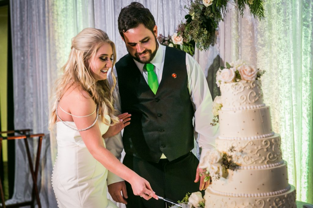 Bride and groom cutting cake at a West Palm Beach wedding