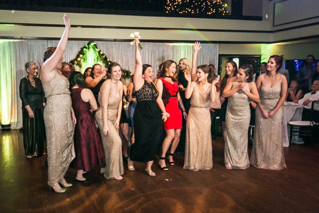 Women on the dance floor after bouquet toss at a West Palm Beach wedding