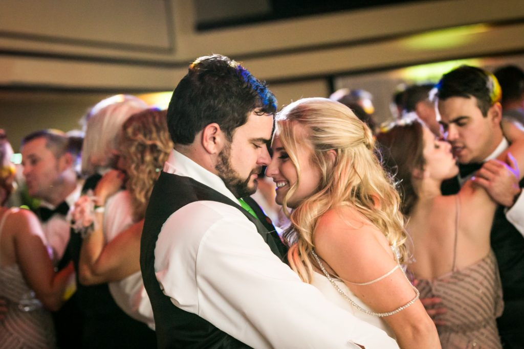 Bride and groom dancing close at a West Palm Beach wedding