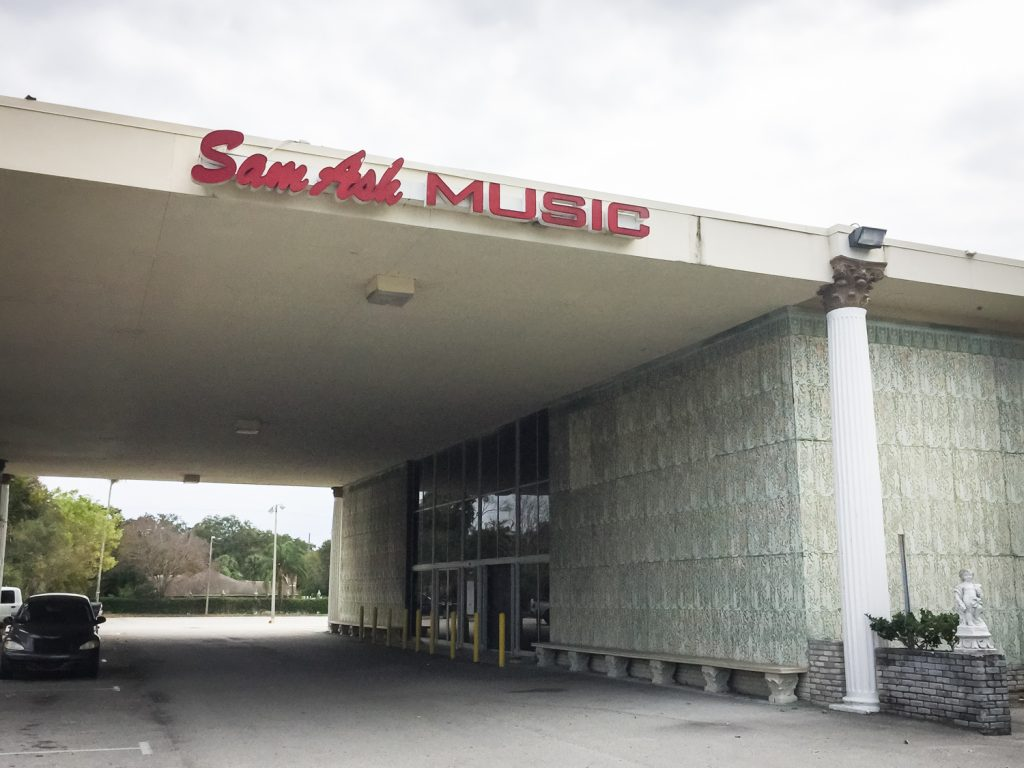 Exterior of the former Kapok Tree Restaurant, now a Sam Ash music store