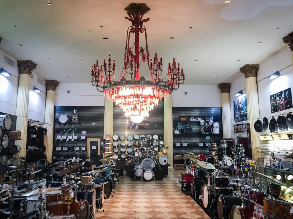 Chandelier and music equipment in the former Kapok Tree Restaurant, now a Sam Ash music store