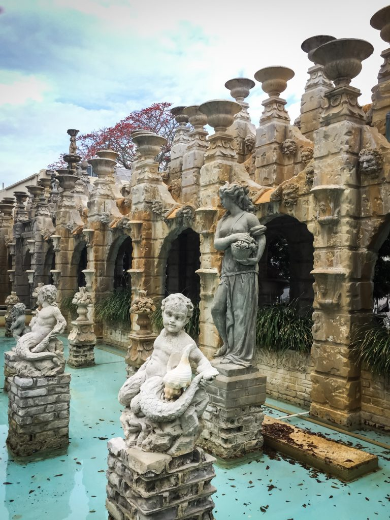 Statues and waterfalls at the Kapok Tree venue