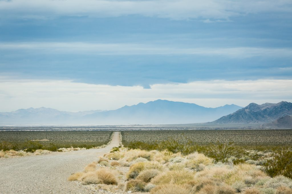 Road leading to mountains in Death Valley National Park