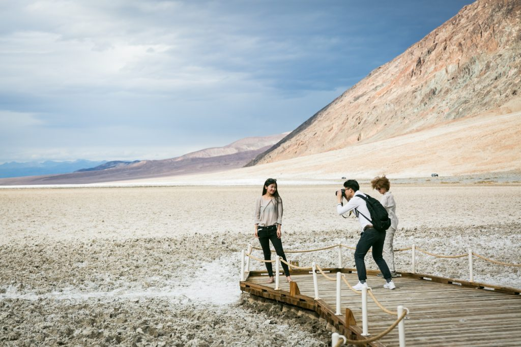 Tourists taking photos in Badwater in Death Valley National Park