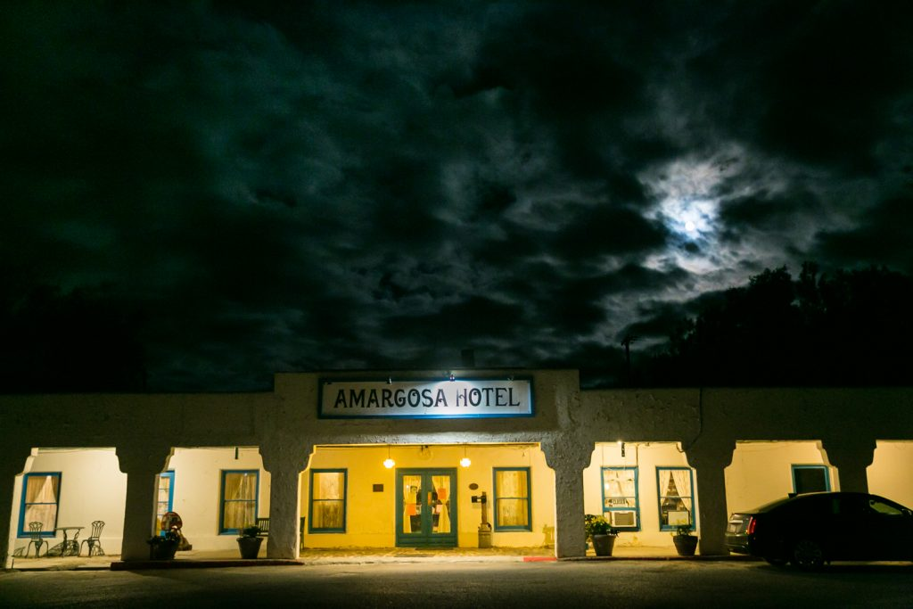Entrance to Amargosa Opera House at night with moon overhead