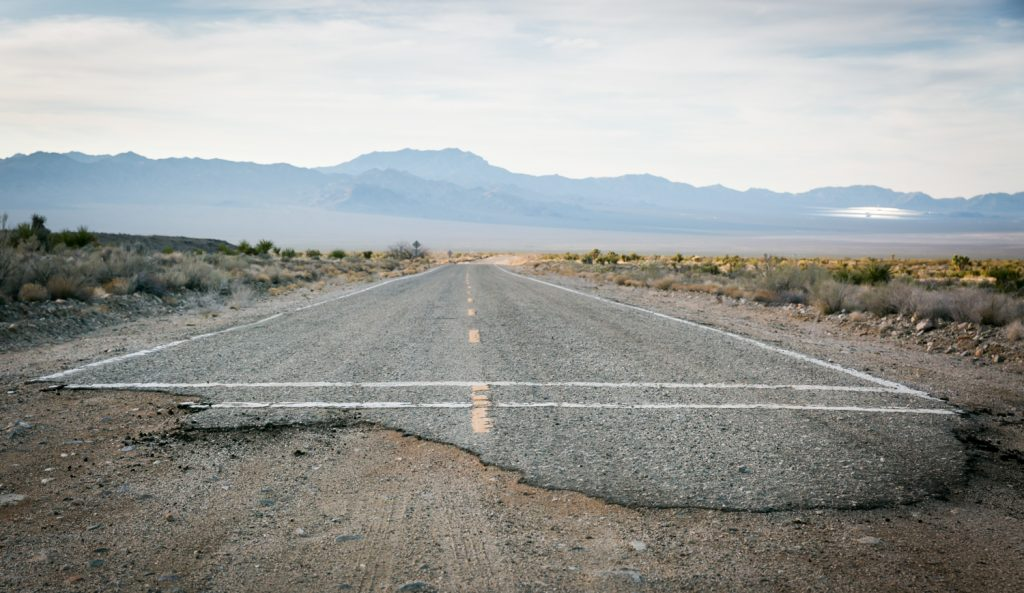 End of pavement on road in Mojave National Preserve