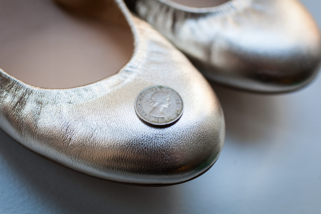 Sixpence in a wedding shoe for an article on creative borrowed and blue wedding ideas