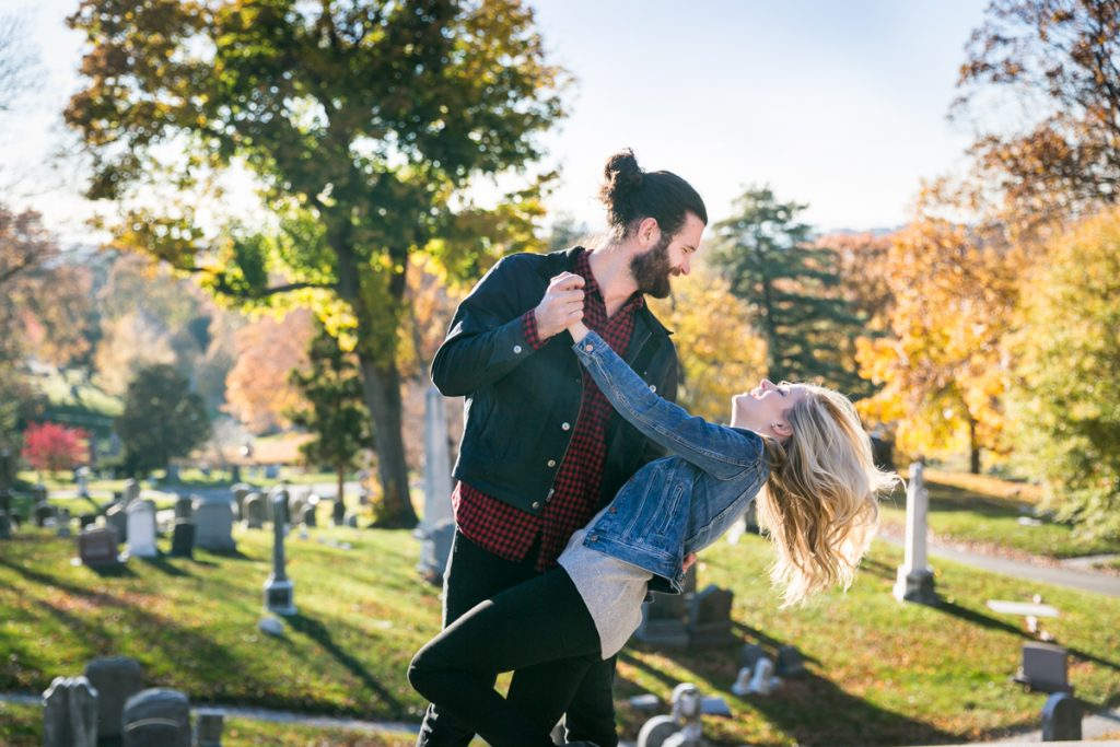 Green-Wood Cemetery engagement photos of couple dancing