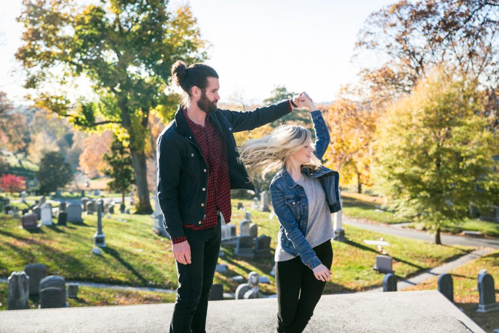 Green-Wood Cemetery engagement photos of man twirling girl