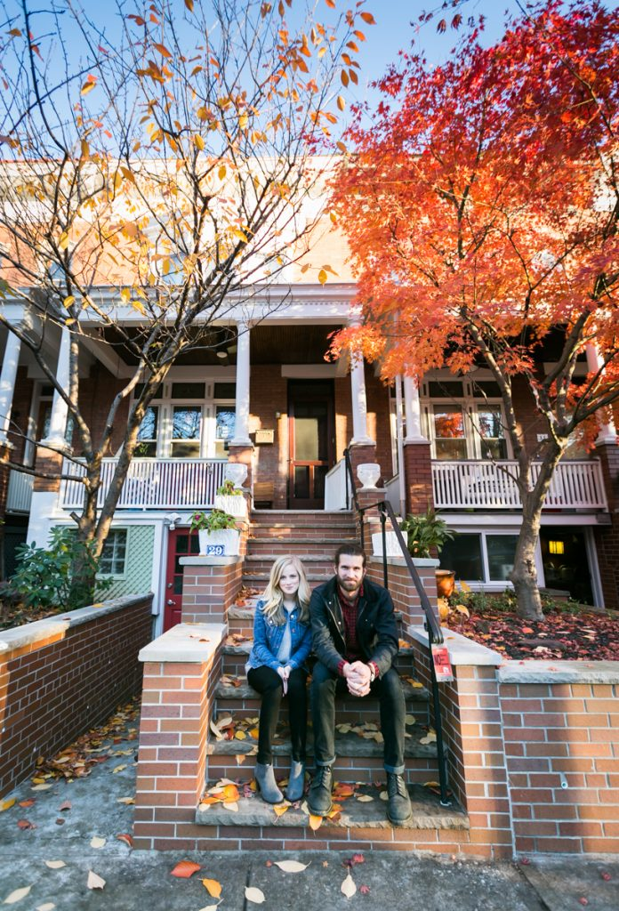Windsor Terrace engagement photos of couple sitting on apartment steps