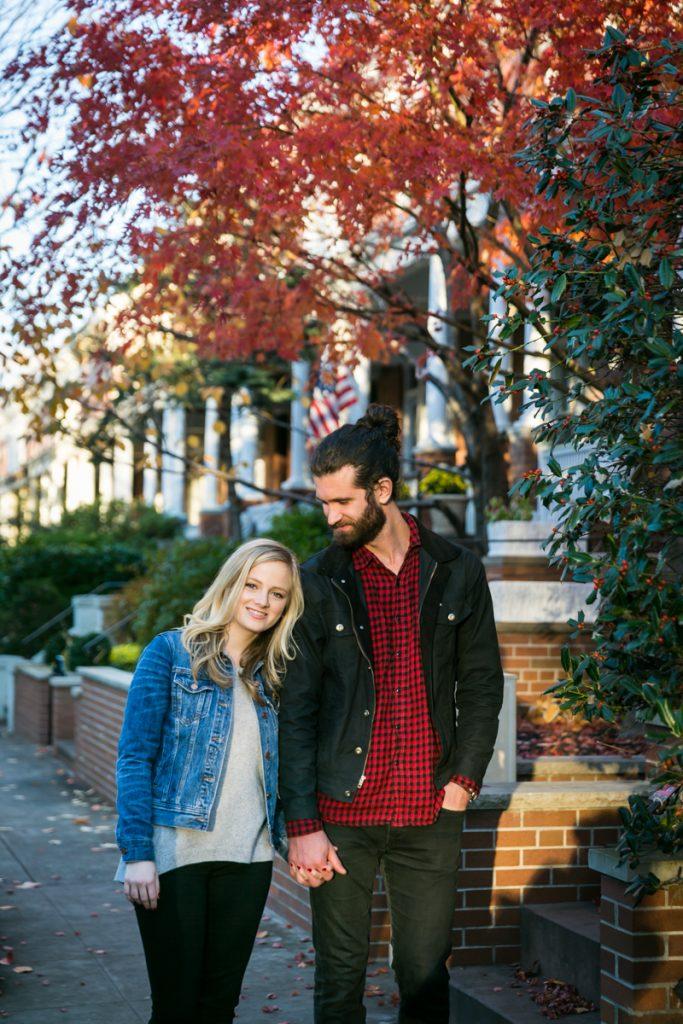 Windsor Terrace engagement photos of couple walking down sidewalk