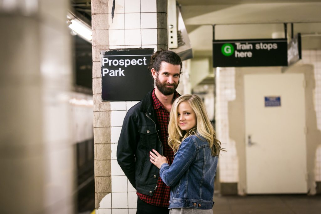 Couple in front of subway station column