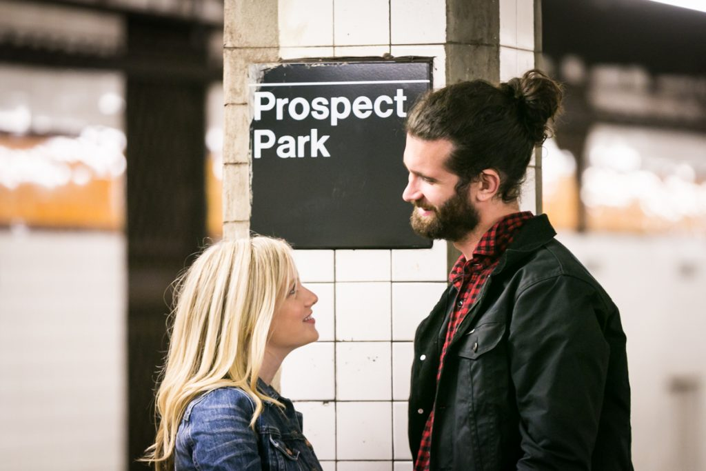 Couple in front of Prospect Park subway sign