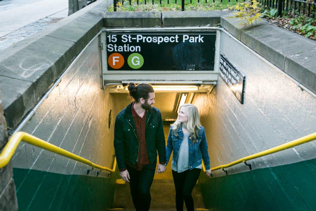 Couple walking up steps of Prospect Park subway station