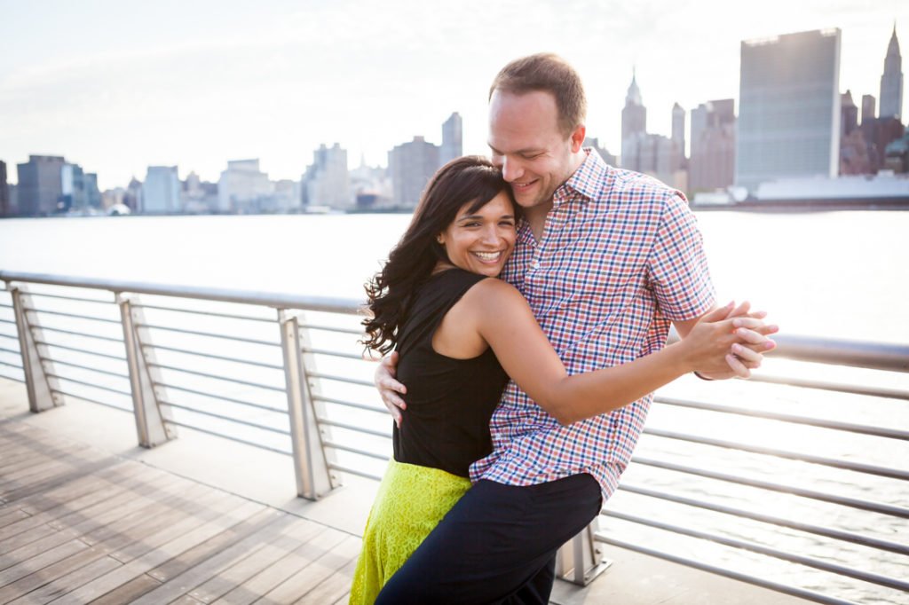 Couple dancing at Gantry Plaza State Park for an article on best engagement photos