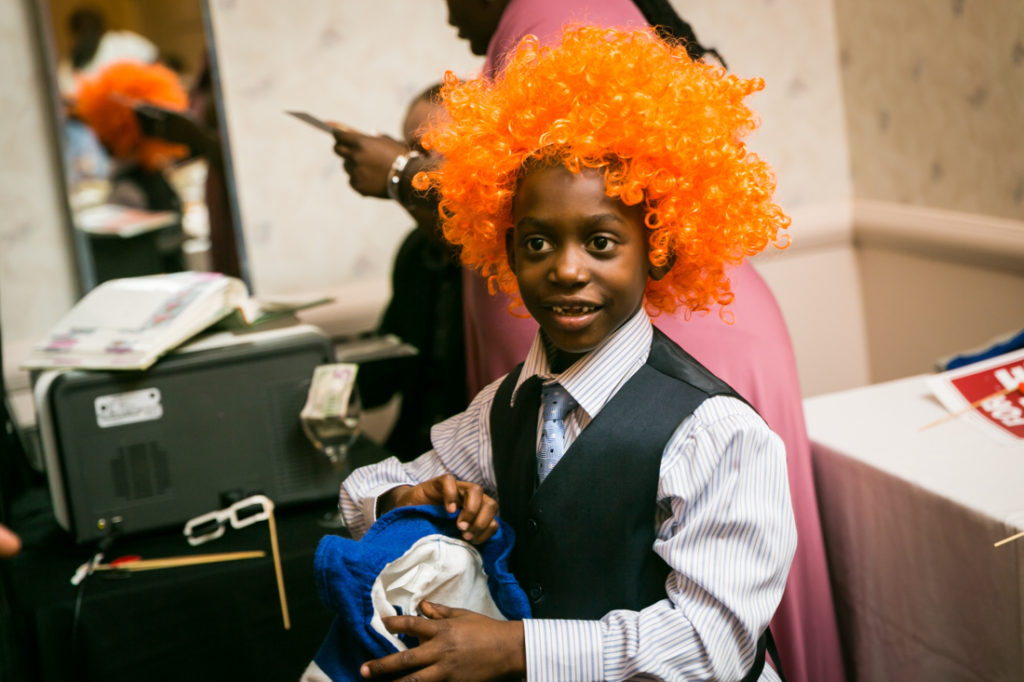 Boy in orange wig at a Glen Terrace wedding