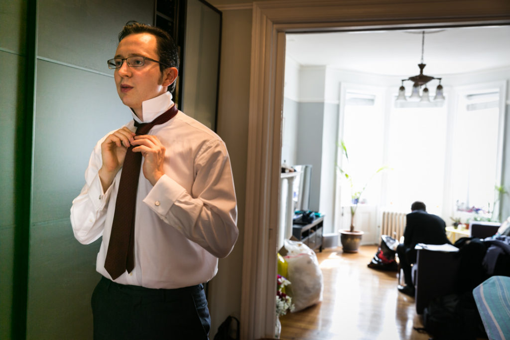 Groom getting ready for a Scottadito wedding in Brooklyn