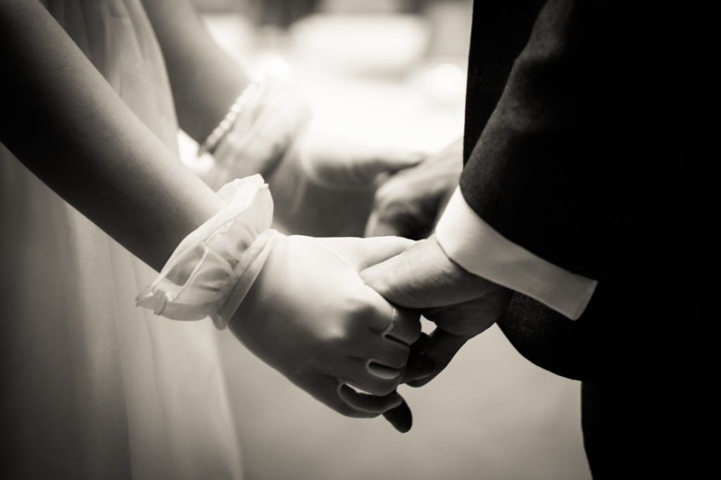 Bride and groom holding hands at a Scottadito wedding