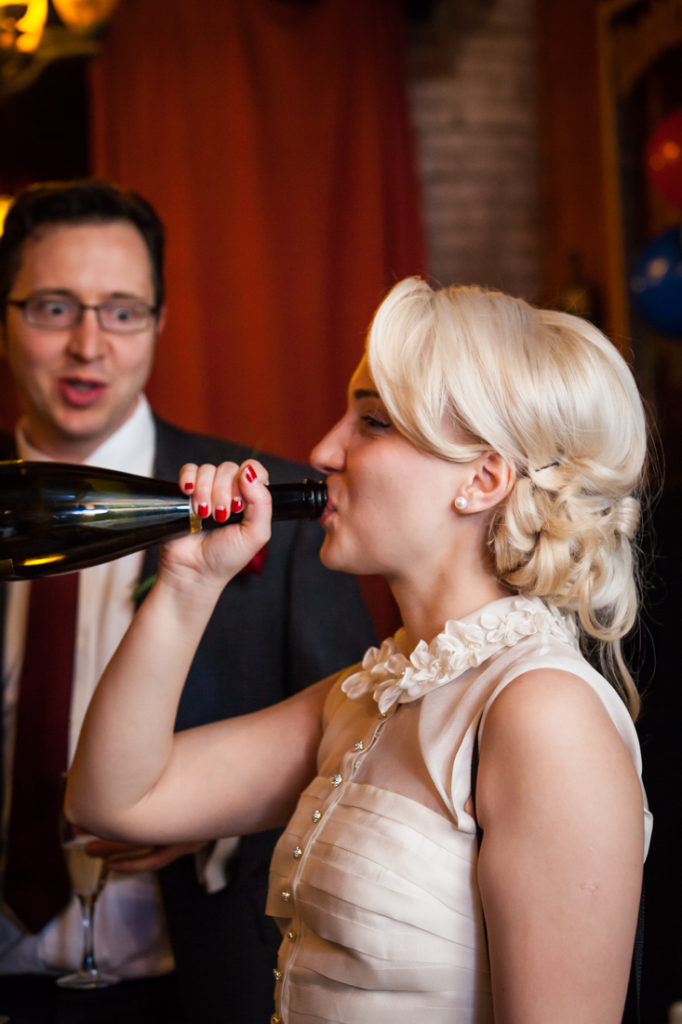 Bride drinking champagne at a Scottadito wedding
