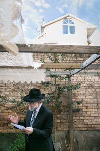 Rabbi speaking for an article on the top fears about wedding photographers