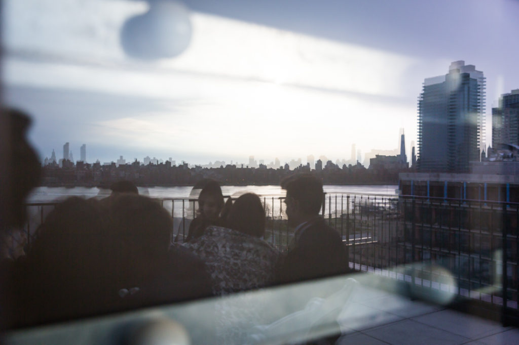 Window reflections at a Wythe Hotel wedding