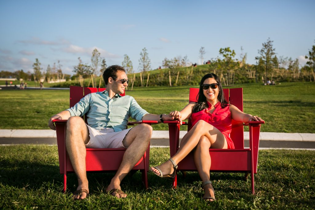 Couple sitting in adirondack chairs on Governors Island for a NYC wedding destination guide