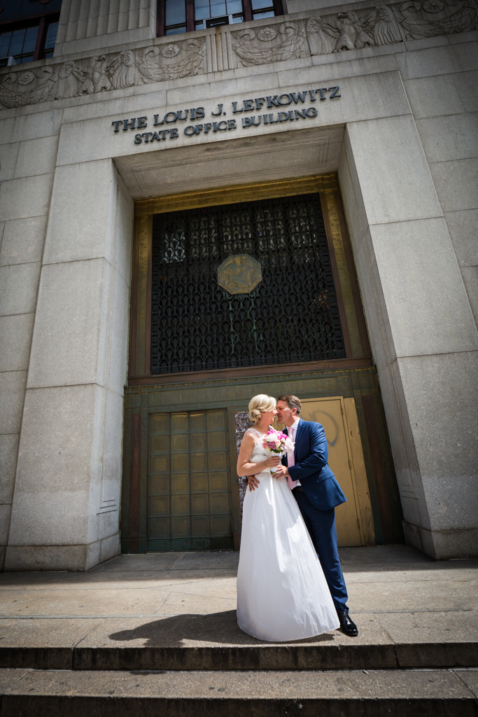 Couple leaving after their NYC City Hall elopement