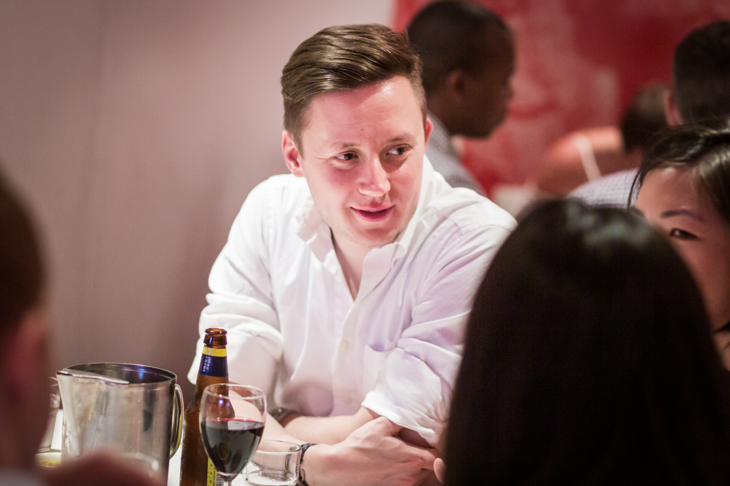 Man at table talking to other guests