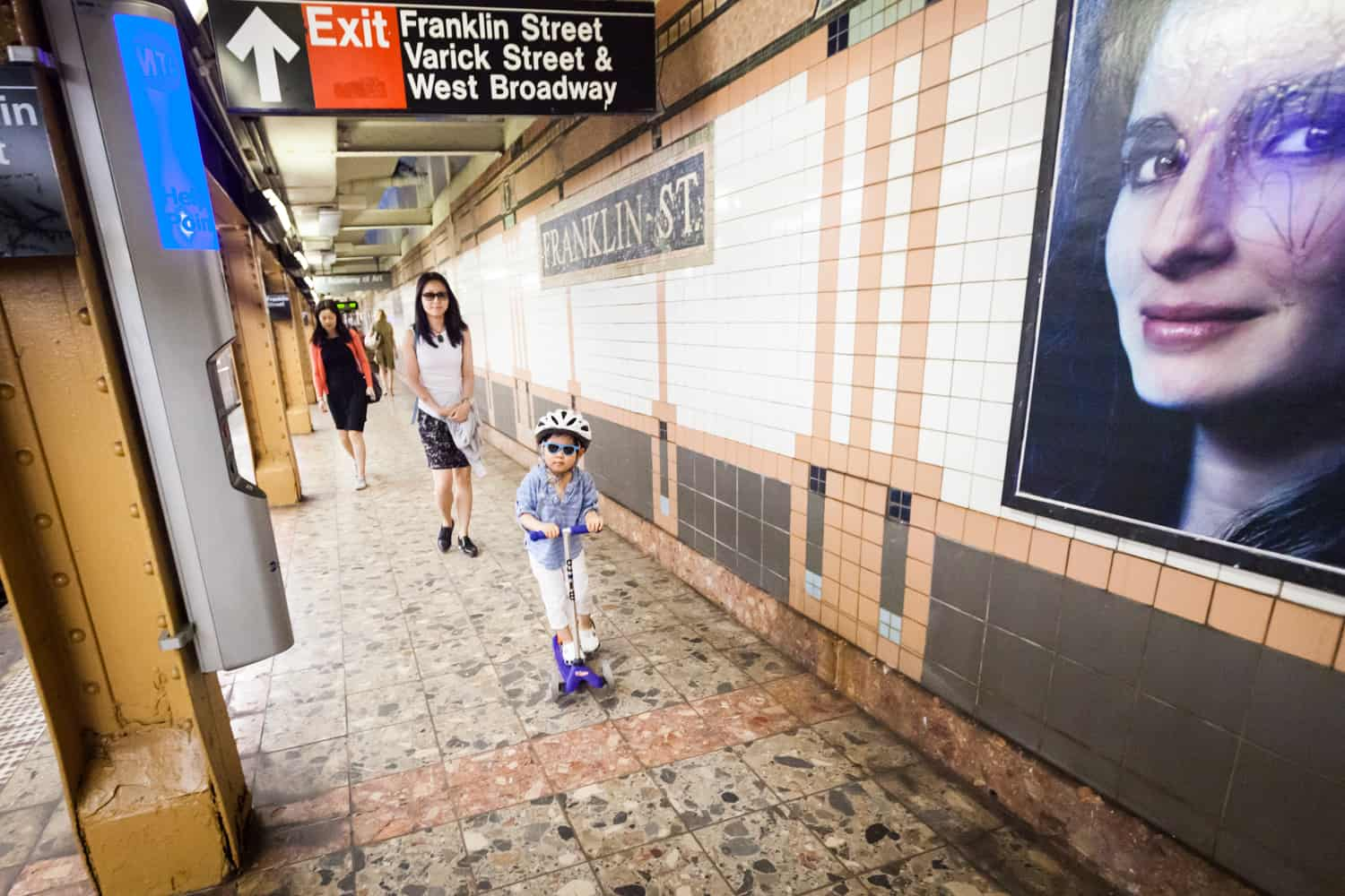 Mother and little boy walking on subway platform