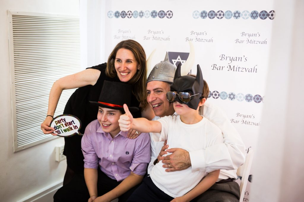 Guests in a photo booth by bar mitzvah photographer, Kelly Williams