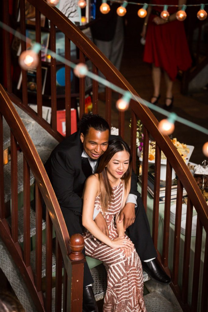 Couple sitting on staircase during a Housing Works Bookstore wedding