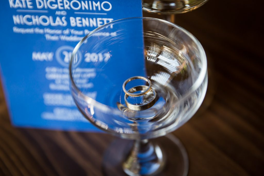 Close up on champagne glass with wedding rings inside