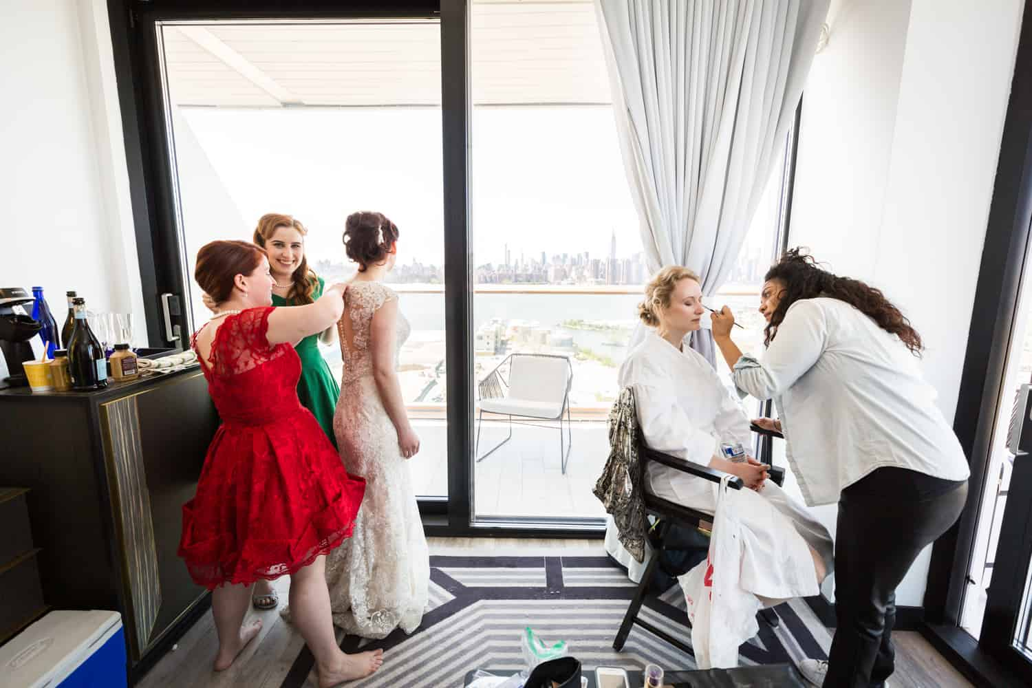 Bride and bridesmaids getting ready in William Vale hotel room with terrace
