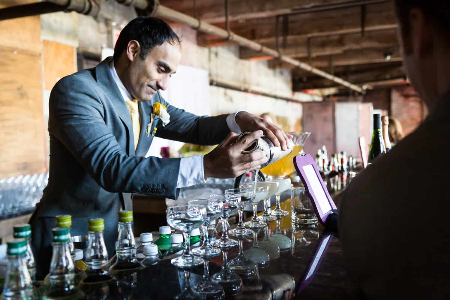 Groomsmen preparing cocktails at a Greenpoint Loft wedding