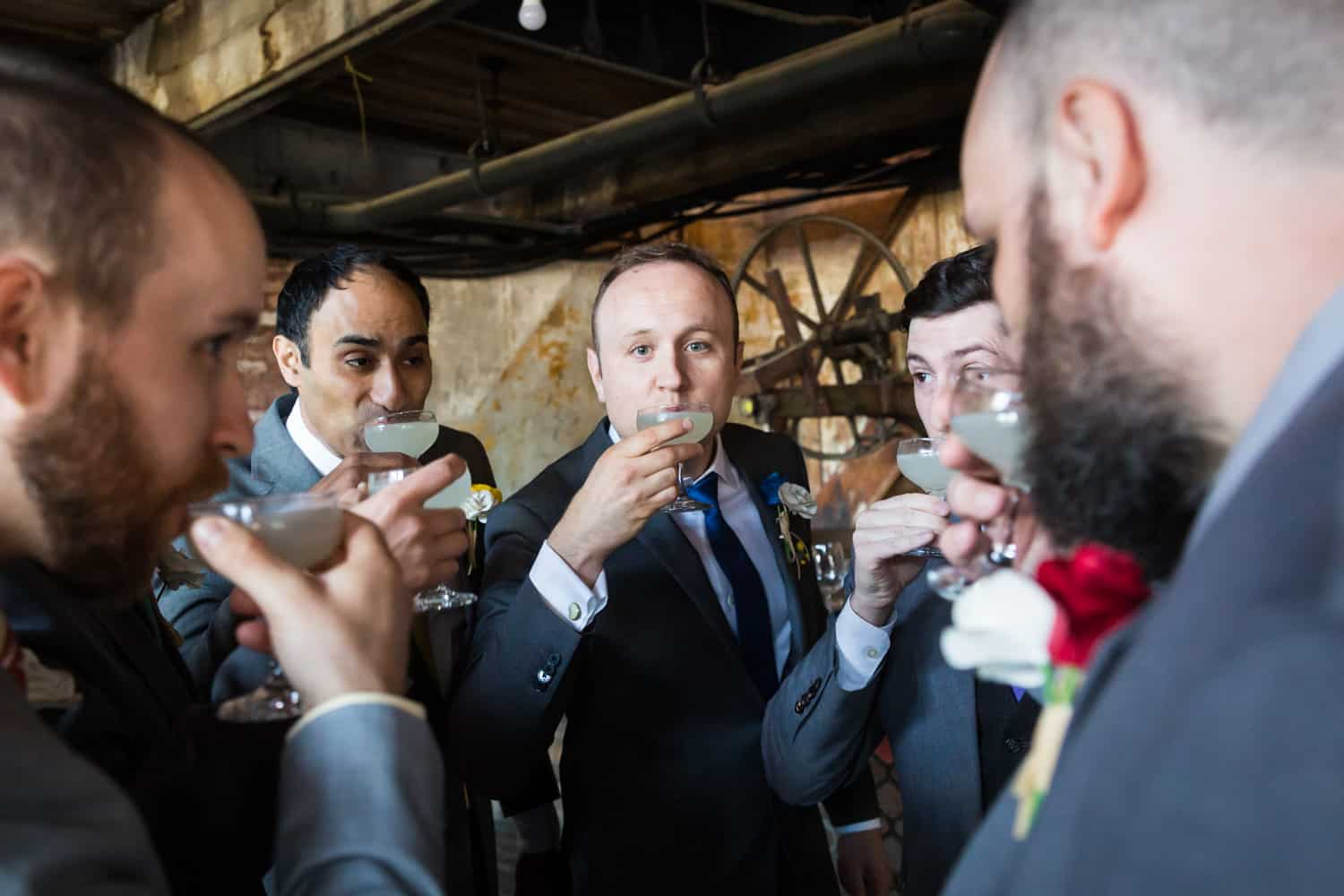 Groomsmen drinking cocktails at a Greenpoint Loft wedding