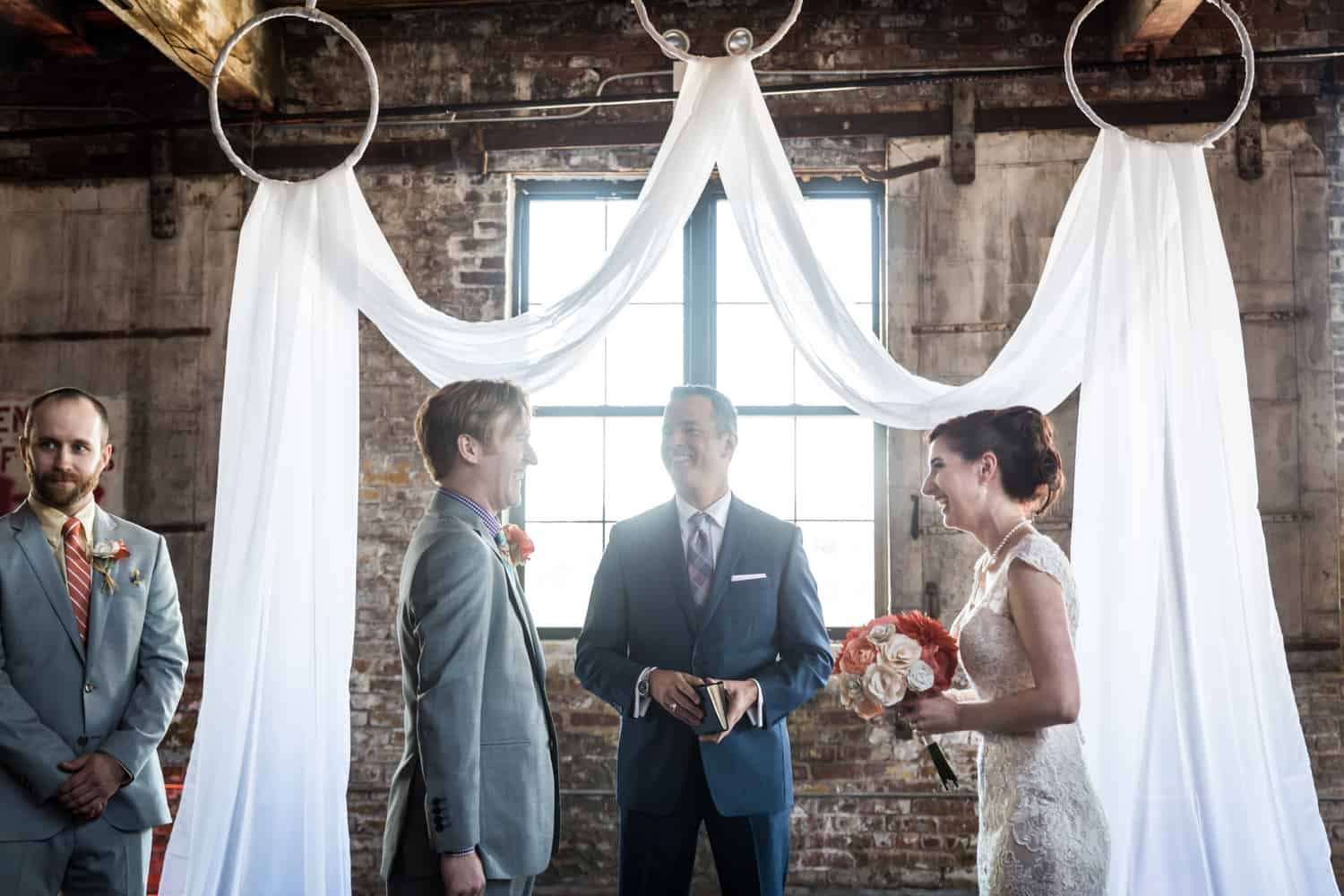 Bride and groom exchanging vows at a Greenpoint Loft wedding